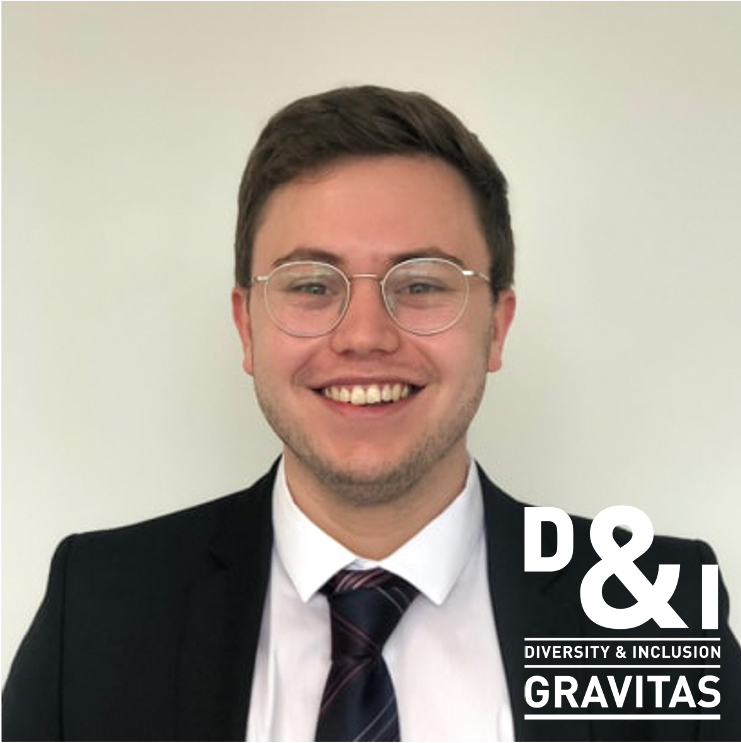 A man smiling with a logo saying 'D&I - Diversity & Inclusion, Gravitas'