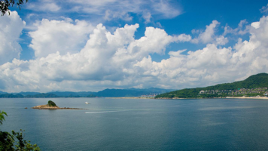 Looking out over the bay at Da Mei Sha Beach, open water enclosed with forest hilly land