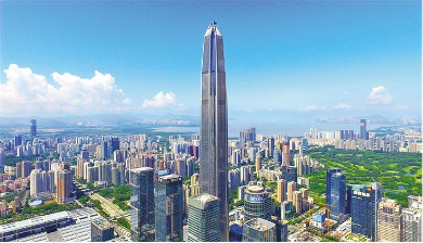 Ariel view of Ping An Finance Centre, shenzhen, Bright blue skies & panning cityscape